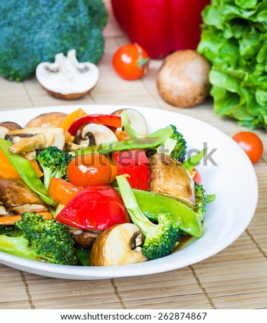 Vegetarian dish, stir fried mixed veggies with soy sauce - stock photo