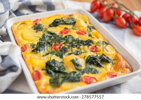 Vegetarian frittata with spinach - stock photo