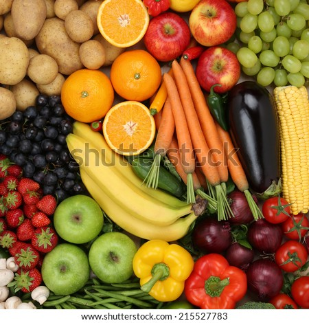Vegetarian fruits and vegetables like apples, oranges and tomatoes forming a background - stock photo