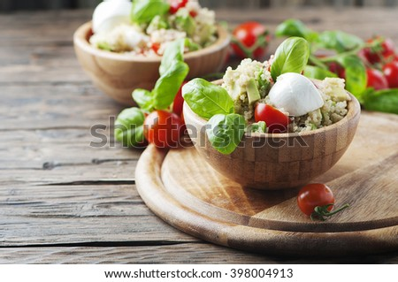 Vegetarian Healthy salad with quinoa, tomato and avocado, selective focus - stock photo