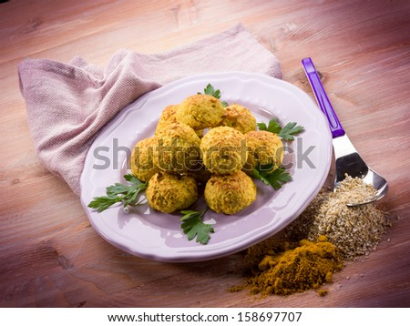 vegetarian meatballs with oat ricotta and curry - stock photo