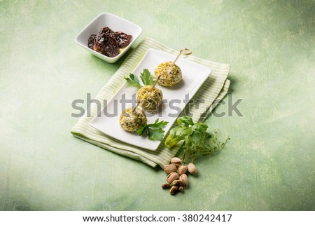 vegetarian meatballs with ricotta dried tomatoes and pistachio - stock photo