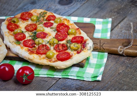 Vegetarian pizza on wooden background - stock photo