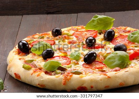 Vegetarian pizza with tomatoes and olives  - stock photo