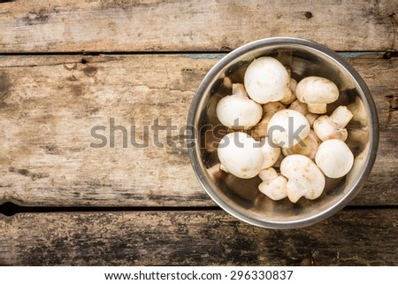 Vegetarian recipe or menu background with copy space. Clean mushrooms in a bowl - stock photo