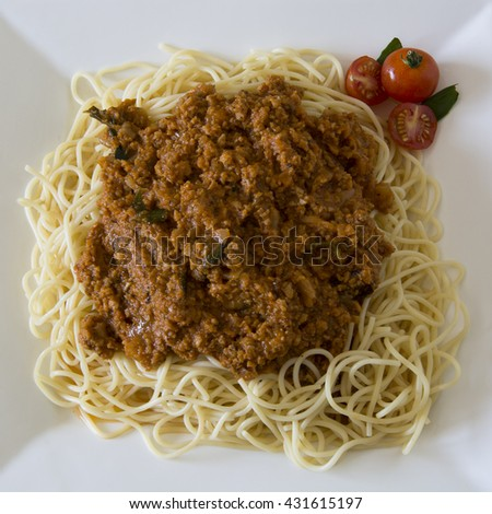 Vegetarian Spaghetti Bolognaise with minced soya (garnished with cherry tomatoes and basil leaves) - stock photo
