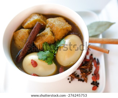 Vegetarian Thai food called Pa lo ,pha-lo phalo Eggs and fried tofu boiled in brown soup - stock photo