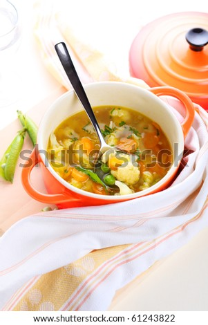 Vegetarian vegetable soup with carrots, peas and cauliflower - stock photo