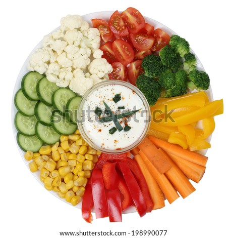Vegetarian vegetables plate with paprika, carrots and tomatoes with yogurt dip - stock photo