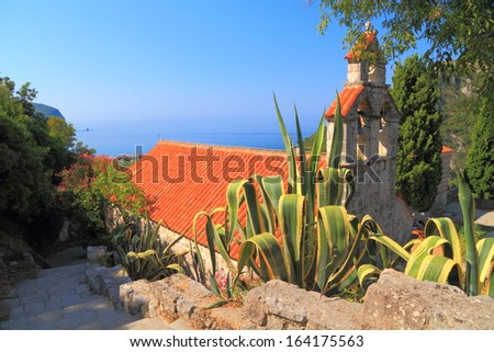 Vegetation surrounding an old orthodox monastery near the Adriatic sea - stock photo