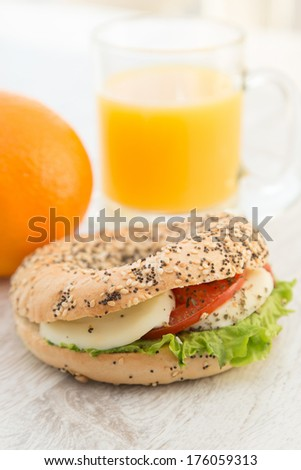 Vegeterian sandwich and a cup of juice on the background - stock photo