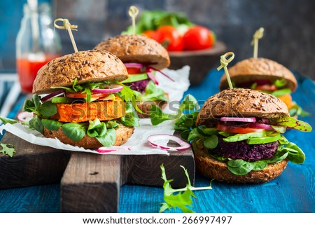 Veggie beet and carrot burgers with avocado - stock photo