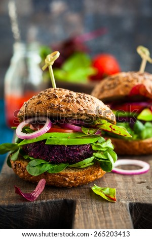 Veggie beet and quinoa burger with avocado - stock photo