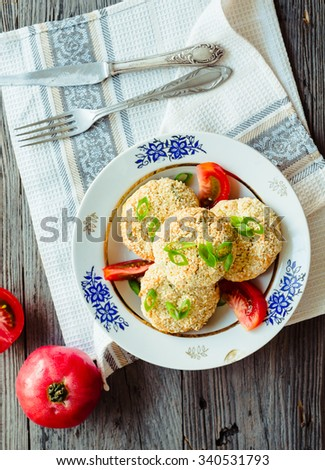 veggie burgers from beans and chickpeas with tomato and herbs, vegetarian food,dinner - stock photo