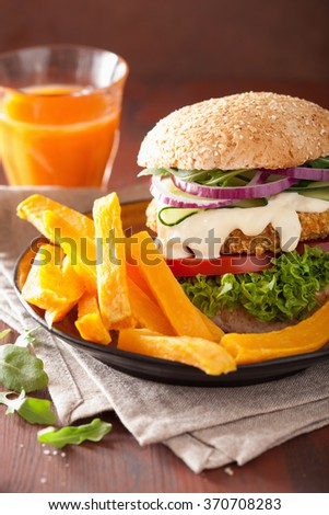 veggie carrot and oats burger with cucumber onion - stock photo