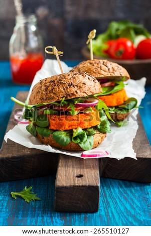 Veggie carrot burger with avocado - stock photo
