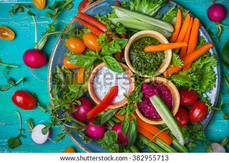 Veggie crudite platter with three different dips - stock photo