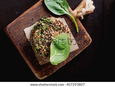 Veggie quinoa burgers with  lettuce, tomato and spinach - stock photo