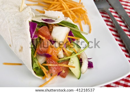 Veggie wrap filled with various vegetables. Selective focus. - stock photo