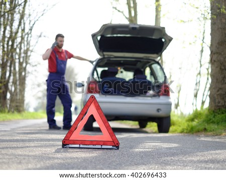 Vehicle breakdown red triangle road - stock photo