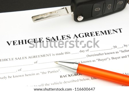 Vehicle Sales Agreement Document Form with orange Pen and Car Key - stock photo