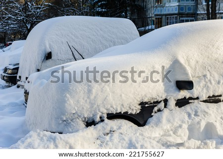 vehicles covered with snow - stock photo