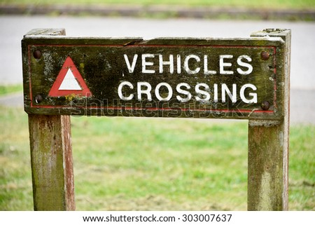 Vehicles Crossing Sign - stock photo