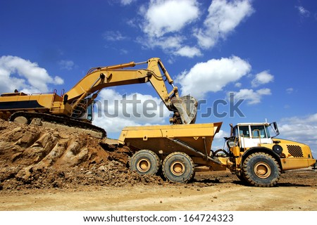 vehicles on a construction site - stock photo