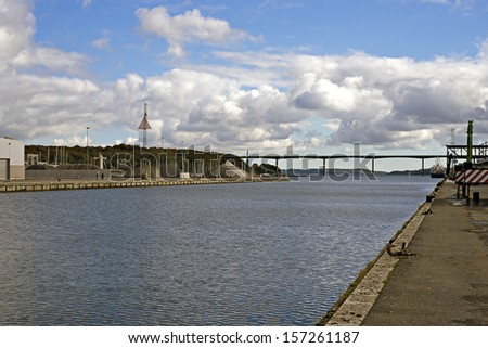 Vejle harbor and Vejle Fjord Bridge - stock photo
