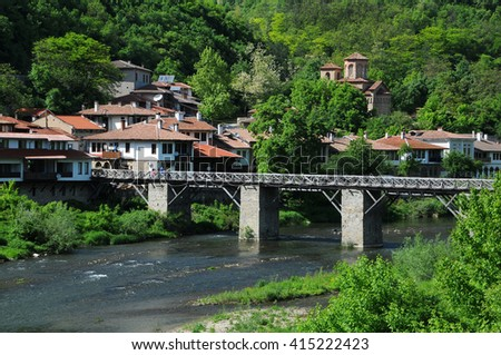 VELIKO TARNOVO, BULGARIA - MAY 1, 2016: Wooden bridge in Asenov district of the town and St. Dimitri Church in the background - stock photo