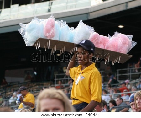 Vendor selling cotton candy - stock photo