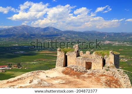 Venetian fortress built above large green valley near Argos, Greece - stock photo