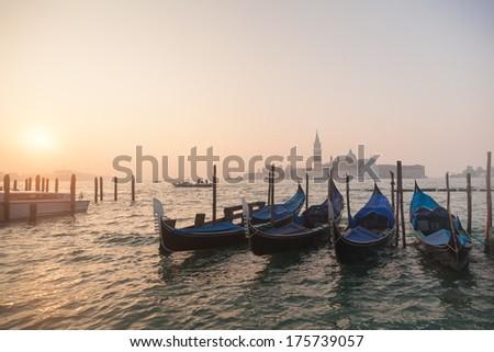 Venetian gondolas at sunrise in venice, Italy  - stock photo