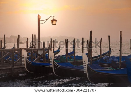 Venetian gondolas at sunrise in venice, Italy
