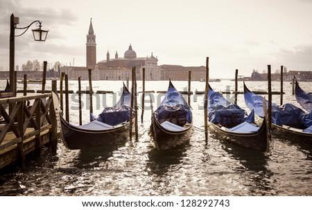 venetian gondolas with the san giorgio maggiore - stock photo