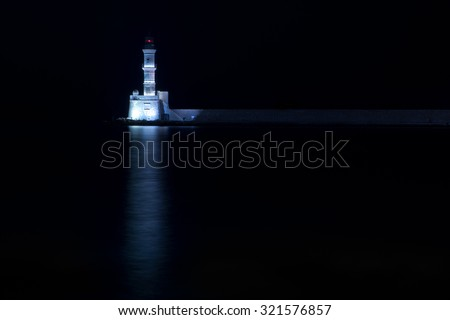 Venetian lighthouse in Chania harbor at night, Crete - stock photo