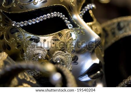 Venetian mask on black background - stock photo
