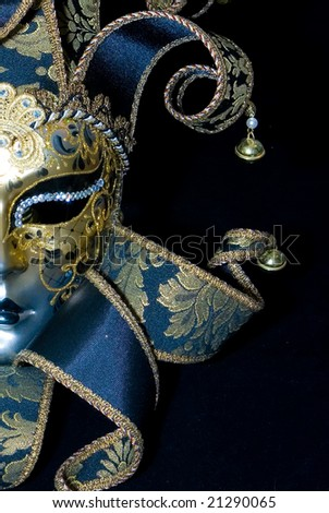 Venetian mask on black background - stock photo