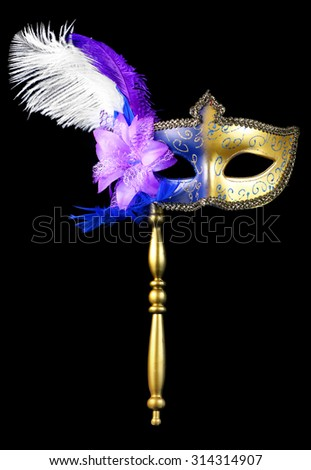 Venetian masquerade or mardi gras mask isolated on a black background - stock photo