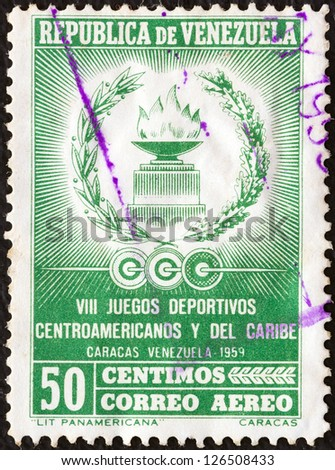 VENEZUELA - CIRCA 1959: A stamp printed in Venezuela issued for the 8th Central American and Caribbean Games shows Eternal Flame, circa 1959. - stock photo