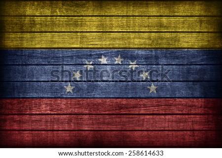 Venezuela flag pattern on wooden board texture ,retro vintage style - stock photo