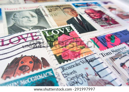 VENICE - APRIL 15: Aged USA stamps texture (US postal service - author's name not mentioned in the original stamp) APRIL 15, 2015 in Venice - stock photo