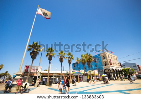 VENICE BEACH, CA - AUG 14: The promenade at Venice Beach CA on Aug 14, 2012. Located in Los Angeles County this beachfront area is known for its Ocean Front Walk pedestrian promenade - stock photo