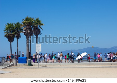 VENICE BEACH, CA - AUG 14:  View at Venice Beach in Los Angeles CA on Aug 14, 2012.  Venice is one of LA's most popular beaches attracting surfers, skateboards, bohemians, musicians and tourists.  - stock photo