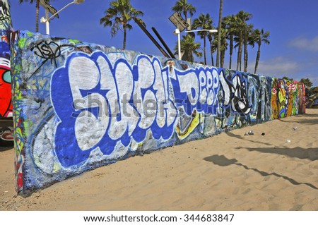 VENICE BEACH, CALIFORNIA. CIRCA JULY 2013. Made famous its famous bodybuilders, graffiti, Green Doctors and other oddities, Muscle Beach near Los Angeles is a popular tourist attraction. - stock photo