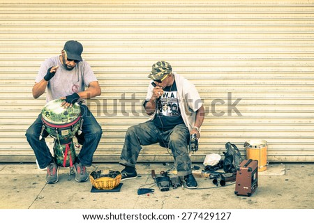 VENICE BEACH - MARCH 20, 2015: musicians playing live on dirty sidewalk in Venice Beach Boardwalk. A lot of street artists are based performers at this place in the californian coast of Los Angeles - stock photo
