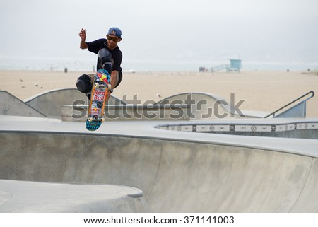 Venice, California, United States - March 18, 2015: A skateboarder performs an air trick during an afternoon workout at Venice Skatepark, Venice Beach, California - stock photo
