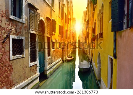 Venice canal at sunrise. Tourists from all the world enjoy the historical city of Venezia in Italy, famous UNESCO World Heritage Site - stock photo