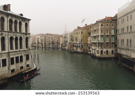 Venice canal in fog background. romantic morning view - stock photo