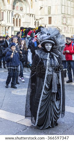 VENICE-FEB 18:Image of a person wearing a complex disguise posing on February 18, 2012 in Venice. Venice Carnival is one of the biggest carnival in the world. - stock photo